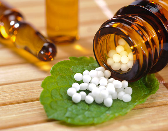 Homeopathy: Addressing people, not disease, in a wholistic way, by encouraging the body to heal itself